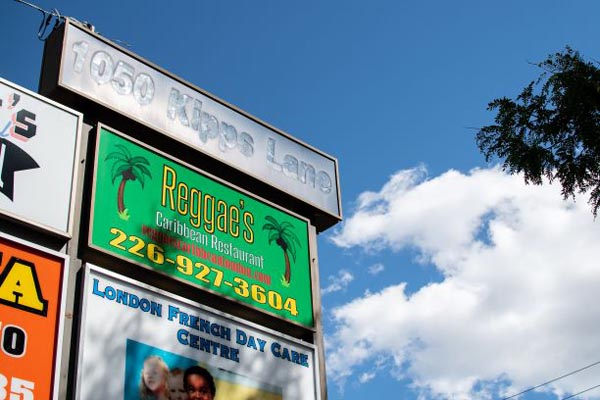 A view of the sign for Reggae's Caribbean Restaurant.
