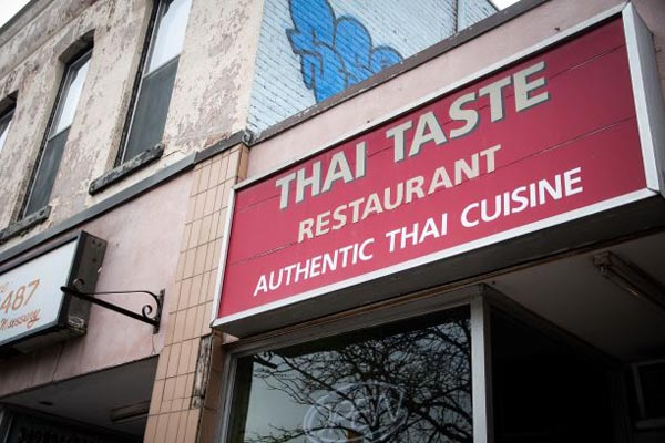 A view of the sign for Thai Taste Restaurant.