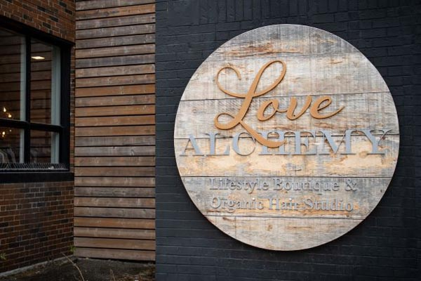 The front sign of Love Alchemy - Lifestyle Boutique & Organic Hair Studio.
