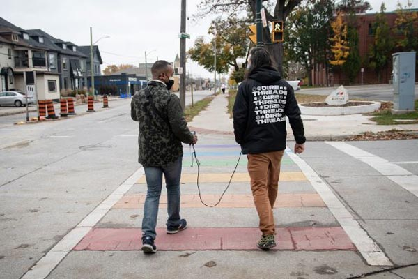Daniel and Adam cross the street toward the Western Fair District.