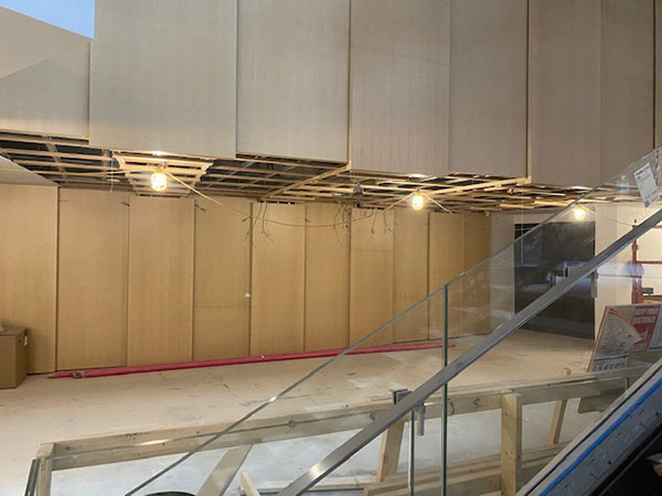 The feature wall in the lobby at the entrance to the orchestra level of the theatre has been refreshed with light maple panels for a brighter appearance.