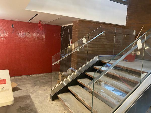 The wall leading into the Auburn Theatre on the lower level has been updated to feature vibrant red tiling.