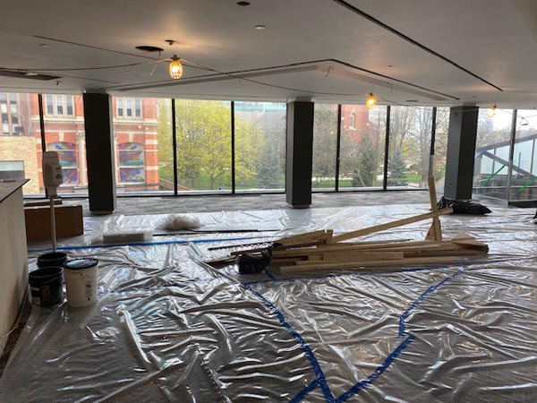 A second view of the fourth-floor Drewlo Lounge, this time looking out toward Richmond Street. Plastic covers the floor, and temporary lighting hangs on the ceiling as work continues in this space.